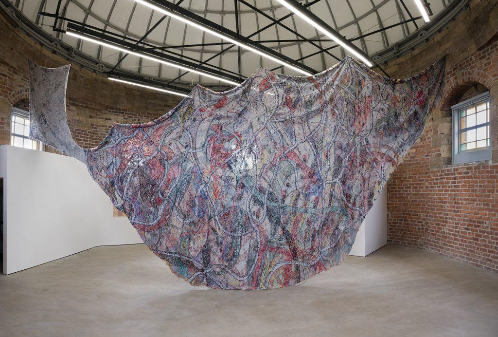 Christian-Newby,--Flower-Necklace-Cargo-Net-,-Collective,-2021.-Photo_-Tom-Nolan.-2